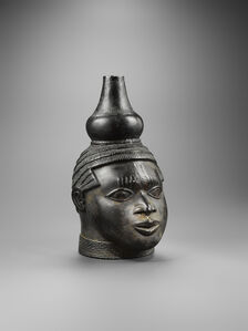 Benin bronze head with gourd