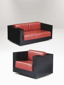 A Saratoga sofa and armchair with a wooden structure and skai upholstery