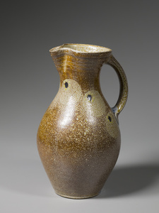 Pitcher, kaolin slip with salt glazed circles, black and yellow dots, and blue glass run on handle