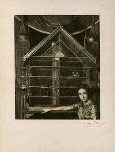 Portrait of Lise Deharme Lise Deharme, chez elle devant sa cage a oiseaux
