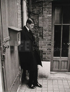 Yves St. Laurent after Attending  Christian Dior's Funeral