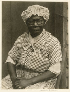 Black Woman in Cap and Gingham Dress