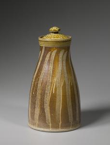 Lidded jar, kaolin slip with alkaline glaze neck and lid and finger swipes