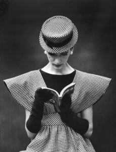 Model Wearing Checked Wide Shoulder Top with Matching Hat Reading Book Looking Down