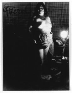 Untitled (smiling nude holding up skirt)