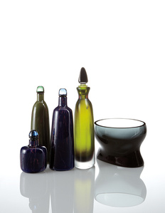 Four decanters and a bowl
