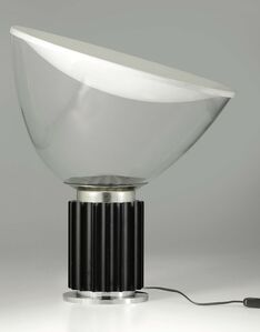 A Taccia lamp in extruded aluminum with a painted metal reflector and a swiveling diffusor in mouth-blown translucent glass, steel base
