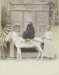 [Arab woman riding a donkey]