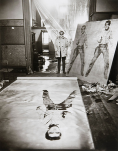 Andy Warhol (in his studio with Elvis Presley Print), New York