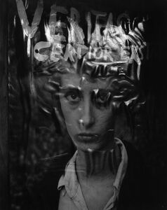 """Untitled (During 1956, Brittin assisted Wallace Berman with the assembly of his piece, """"Panel,"""" which includes a collaged photograph Berman took of his wife, Shirley Berman (who had just returned from the dentist when the picture was taken, and wasn't feeling well). Berman then inscribed the photographic print with the Latin word, """"Veritas."""" The afternoon light was reflecting off the image when Brittin shot this photo of """"Panel."""")"""