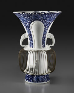 "One of a pair of ""birdcage"" vases"