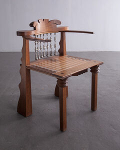 """""""African Chair"""" in claro walnut, leather, ebony, copper and beads."""