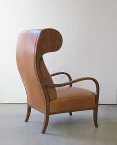 Unusual Wingback Chair, with sweeping arms and curved headrests