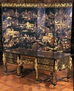 Exceptional bureau with Indian heads and Daphne masks