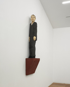 wall sculpture (man in grey suit)