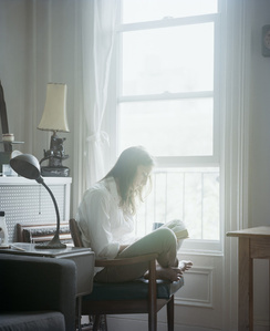 Michelle reading Betty Smith (A Tree Grows in Brooklyn, 1943) from the series Reading Women (2012–2014)