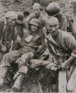 "South Koreans Carrying Marine Capt. Frances ""Ike"" Fenton"
