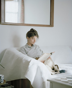 Megha reading Edith Wharton (The House of Mirth, 1905) from the series Reading Women (2012–2014)