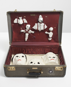 Untitled (suitcase with three heads)
