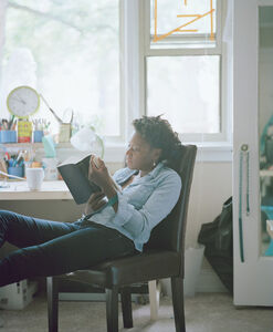 Cauleen reading Gwendolyn Brooks (Blacks, pub. 2008) from the series Reading Women (2012–2014)