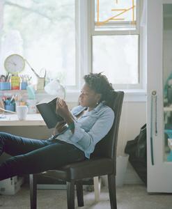 Cauleen reading Gwendolyn Brooks (Blacks, pub. 2008) from the series Reading Women (2012–2014)