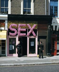 Jordan in the 'SEX' doorway (with man watching)