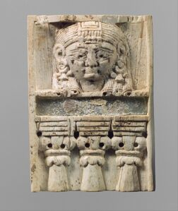 """Furniture plaque carved in relief with a """"woman at the window"""""""