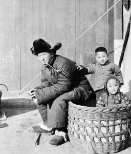 Man and children enjoying the winter sunshine