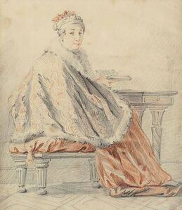 A lady seated at a table