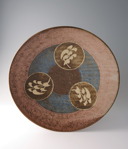 Large platter, rope and slip inlay with wax resist brushwork