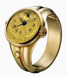 Small gold ring-watch