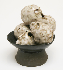 Black Footed Bowl with Five Skulls