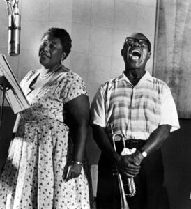 "Ella Fitzgerald and Louis Armstrong recording the album ""Ella and Louis"""