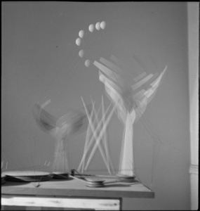 "Dancers and Sphere (maquette for 1939 New York World's Fair) set in motion in Calder's ""small shop"" New York City storefront studio"