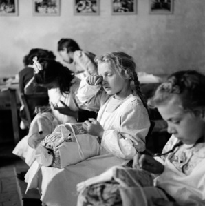 """Tired Eyes"". Orphans in a sewing class, Trieste, Italy, 1947"