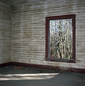 Abandoned Mill House: Brown room with window view of the outside