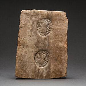 Terracotta Panel with Two Stamped Ibex Roundels and Inscription