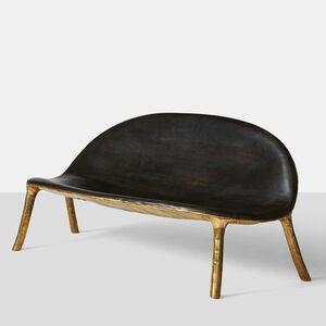 Charred oak & brass sofa