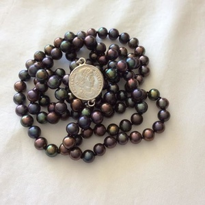 Pearl necklace with cast silver coin