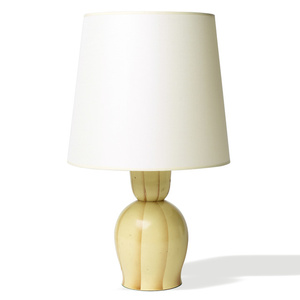 Table lamp with turned bell form and shaded yellow stripes on light yellow base