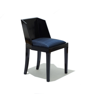Chair with faceted back