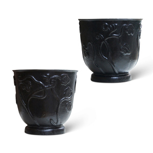 Pair of planters with stylized floral reliefs in painted cast iron