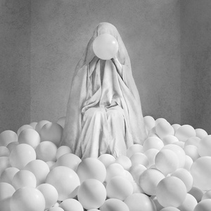 Sheeted Figure with Balloons in Room