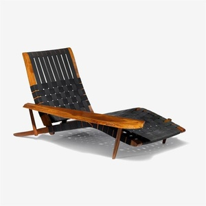 Lounge chair in walnut, with one free-form armrest and adjustable back, the seat and back are webbed