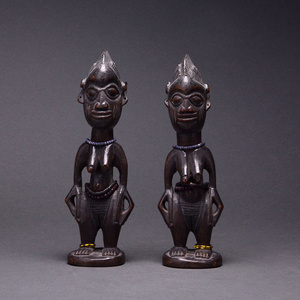 Pair of Yoruba Wooden Ibeji Dolls with Cowrie Shell Cloaks