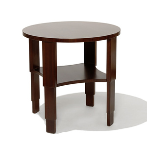 Table with stepped legs and round top