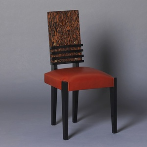 Six chairs with four curved strips.