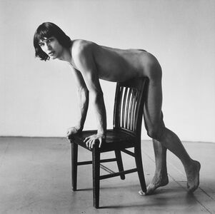 Daniel Schock Leaning Against Chair