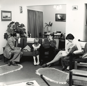 Dominee S M van Vuuren of the Dutch Reformed Church, Whitfield, at prayer with a family during a pastoral call, Boksburg