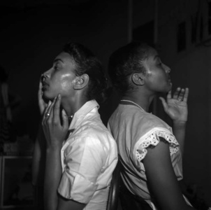 Two young models check their make-up backstage, Harlem